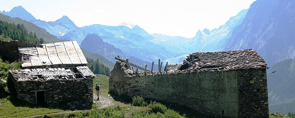 man between ruins in Val Veni - Description of walking the TMB - the northern half