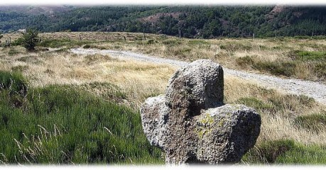 Hiking along the Best of The Regordane Way - stone cross near Chassezac Gorge
